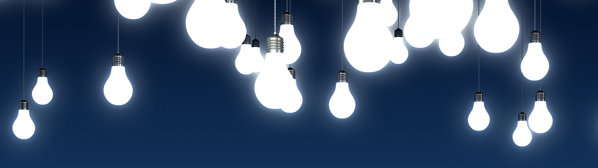 Trove of lightbulbs burning bright against a blue background