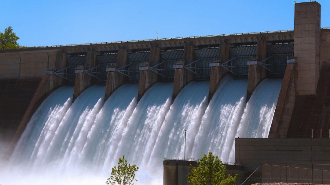 Image of floodgates open and water rushing