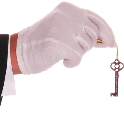 White Glove Holding a Dangling Key Symbolizing Key To Marketing Success